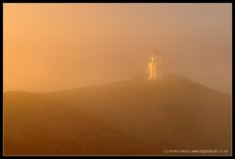 Sunset in fog at Cape Reinga